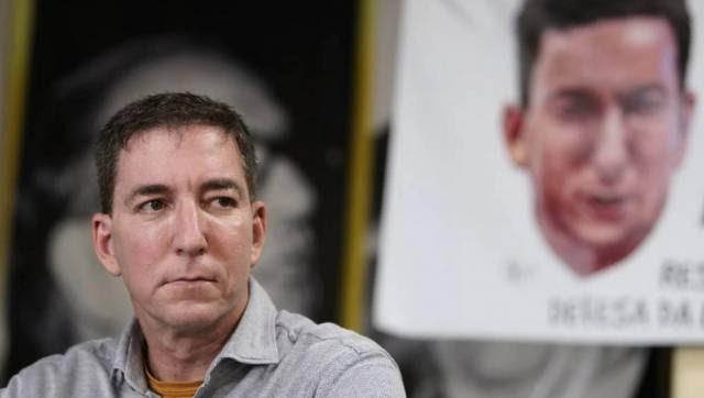 Juiz rejeita denúncia contra Greenwald, mas o acusa de auxiliar hackers