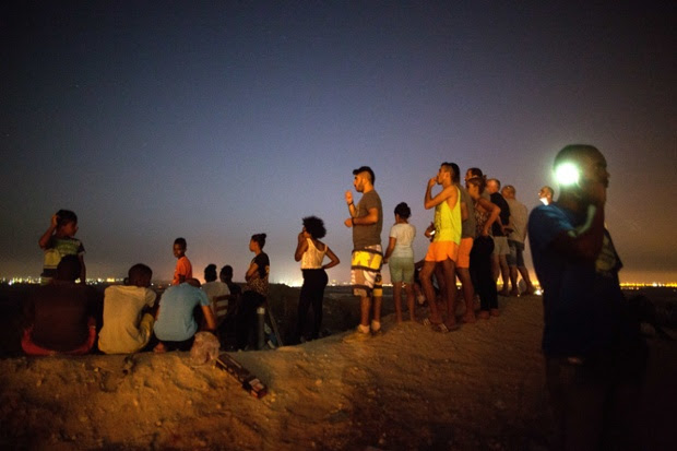 Israelis watch the fighting between the Israeli army and Palestinian militants from a hill overlooking the Gaza Strip.
