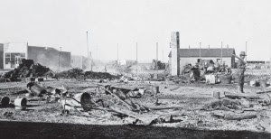 As daylight came to Columbus the evidence of the carnage became clearer. Destroyed in the fire were a block of buildings consisting of the Commercial Hotel, Lemmon & Romney Mercantile, and two small houses. It was here that the greatest number of American deaths occurred. (AdeQ Historical Archives)