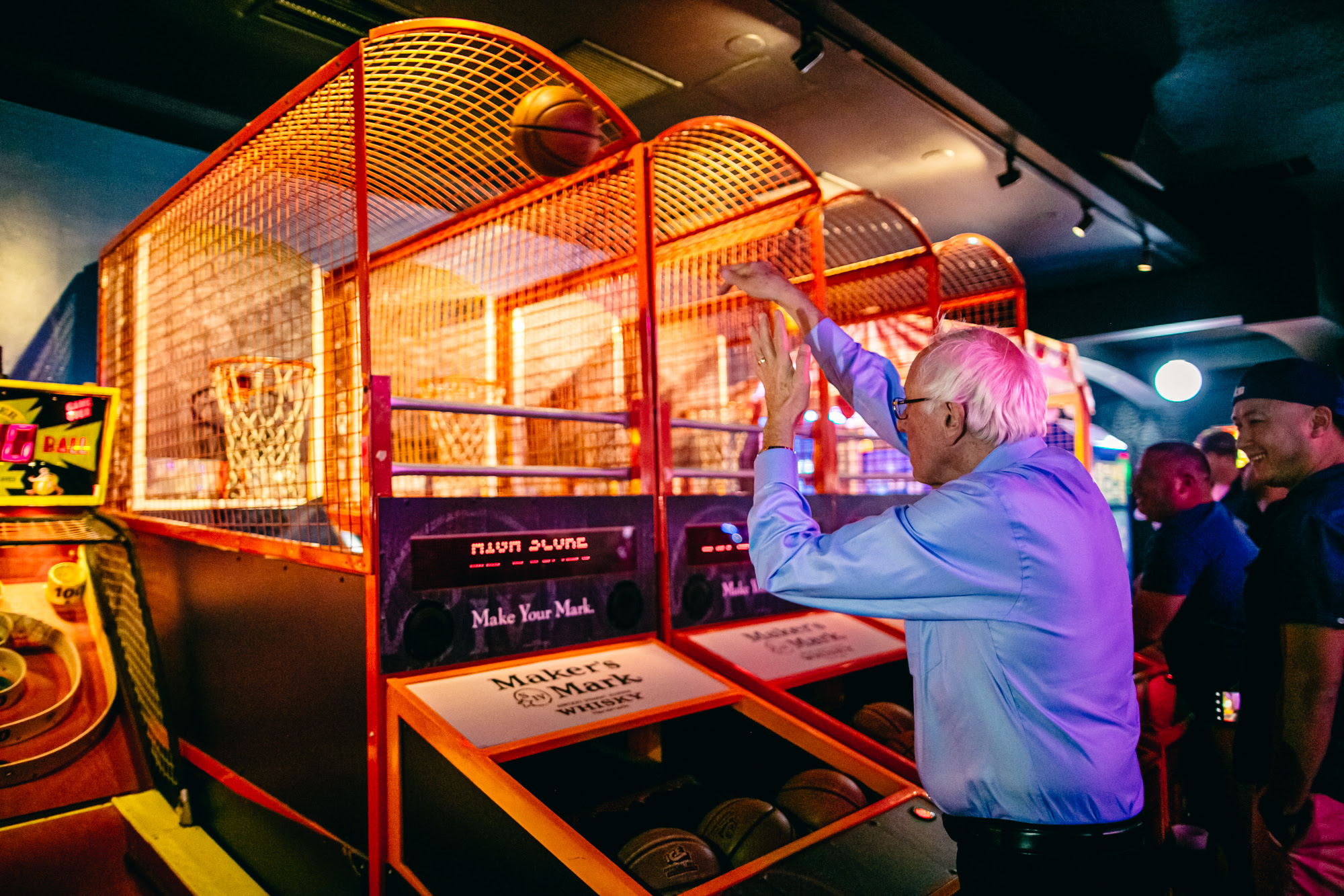 Bernie at an arcade shooting a basketball
