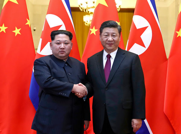 North Korea's leader, Kim Jong-un, with President Xi Jinping of China in Beijing.