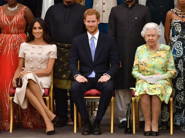 Meghan, Duchess of Sussex, Prince Harry, Duke of Sussex and Queen Elizabeth II at the Queen's Young Leaders Awards Ceremony at Buckingham Palace on June 26, 2018 in London, England