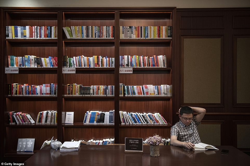 A Huawei employee takes a break at the staff library. The tech giant has more than 180,000 employees worldwide, with nearly half of them engaged in research and development