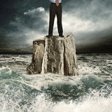 Standing on the rock in the sea Royalty Free Stock Photos