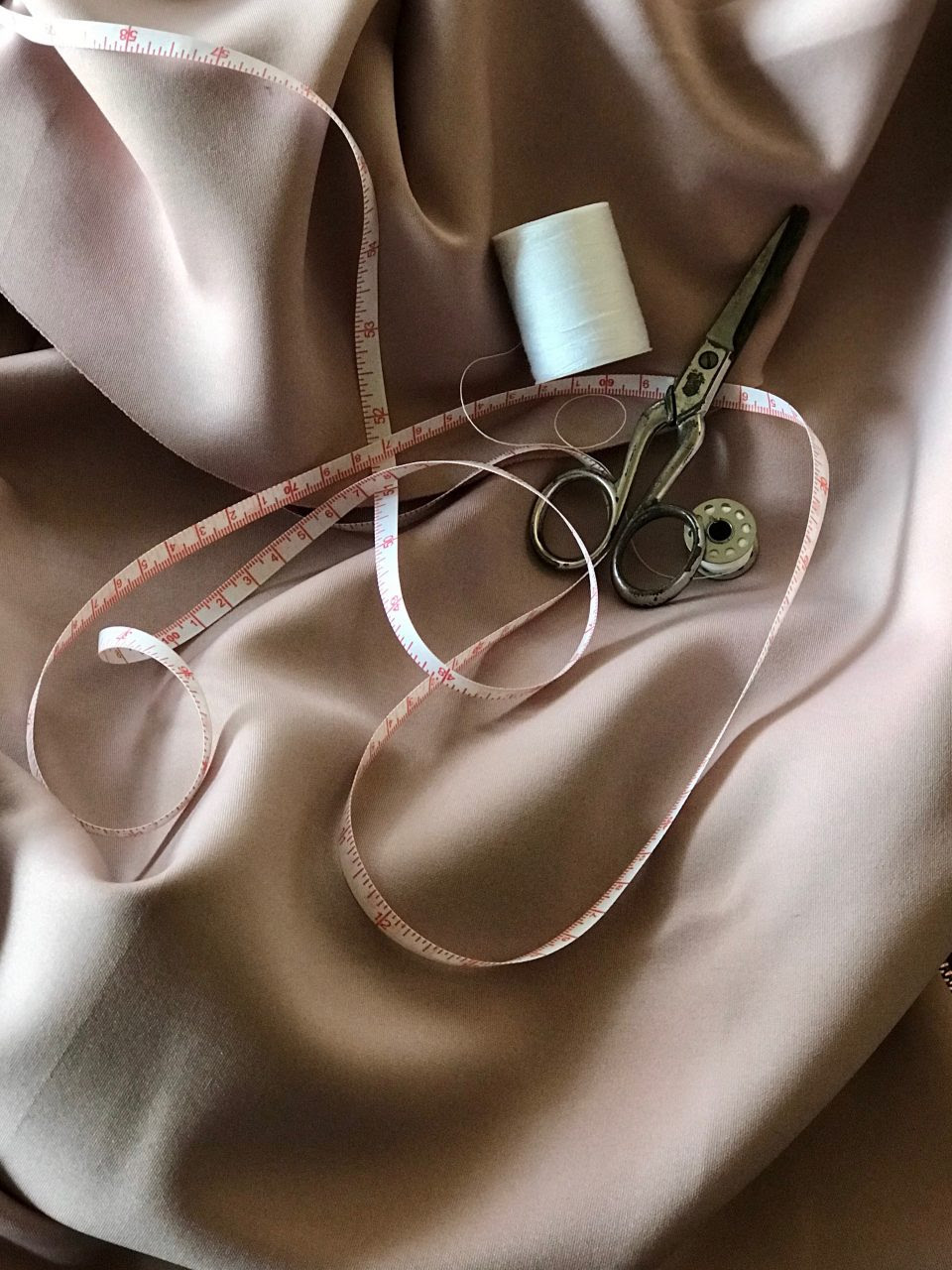 sewing implements on satin