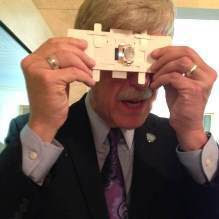 NIH Director Dr. Francis Collins using the Foldscope microscope.