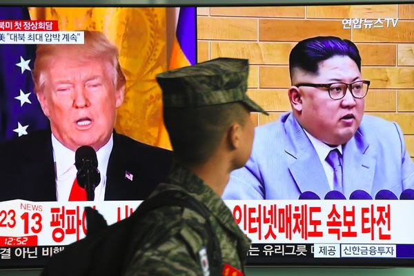 A television screen showing pictures of President Trump and North Korea's leader, Kim Jong-un, in Seoul, South Korea, on Friday.