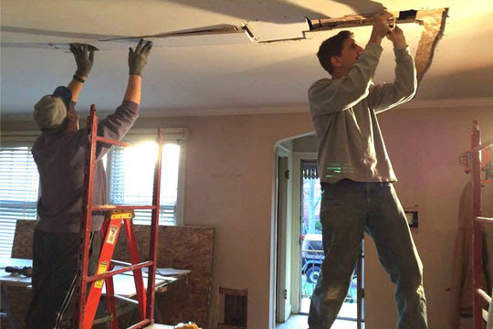 Joe working on remodeling house