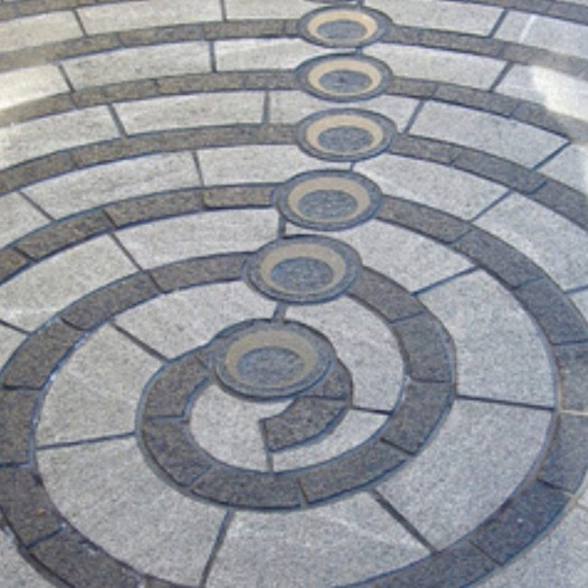 Depiction of minor lunar standstill outside the National Museum of the American Indian, Washington, DC.  These moon phases represent circular markings found in New Mexico's Chaco Canyon. Image via Flickr user Catface3.