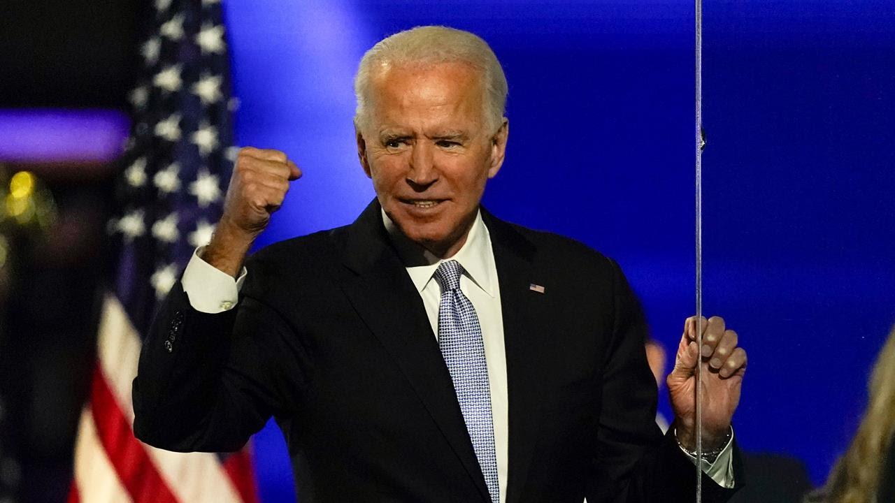 President-elect Joe Biden gestures to supporters, Nov. 7, 2020, in Wilmington, Del.