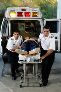 Photo: EMS workers moving a patient from an ambulance
