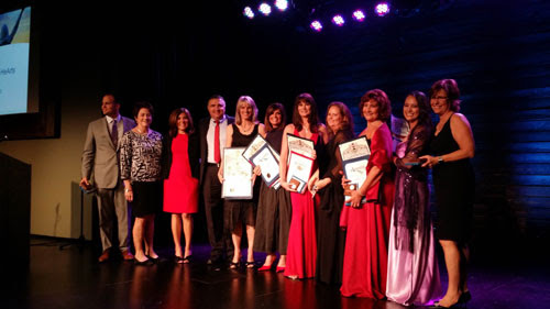 Honorees at the Empowering Hearts Gala benefiting Single Mothers Outreach in Santa Clarita receive recognition from Senator Sharon Runner.