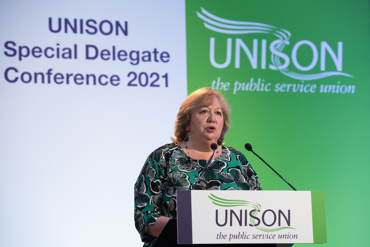 Christina McAnea giving speech in front of Special Delegate Conference 2021 UNISON backdrop