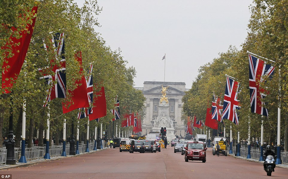 China flags are already flying in the Mall outside Buckingham Palace ahead of the high profile visit this week