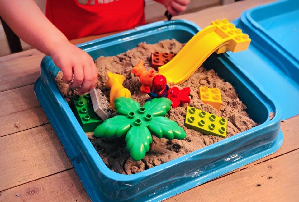 Lego plus sand means a fun sensory bin!