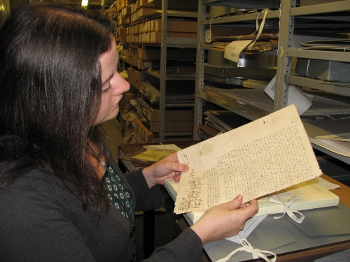 Archivist looking at old document