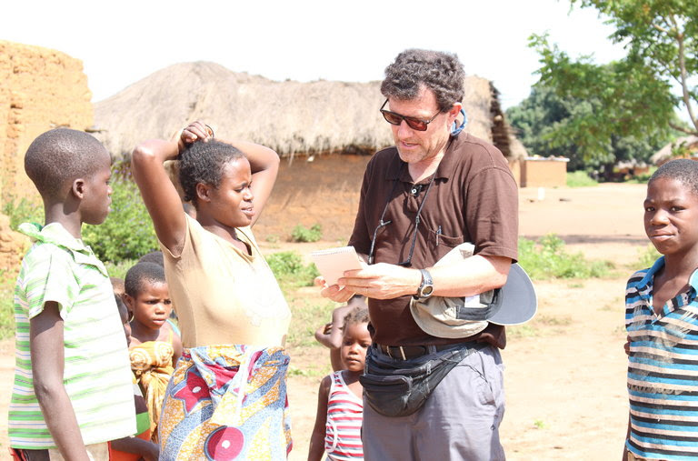 Speaking with villagers in a remote part of northern Angola.