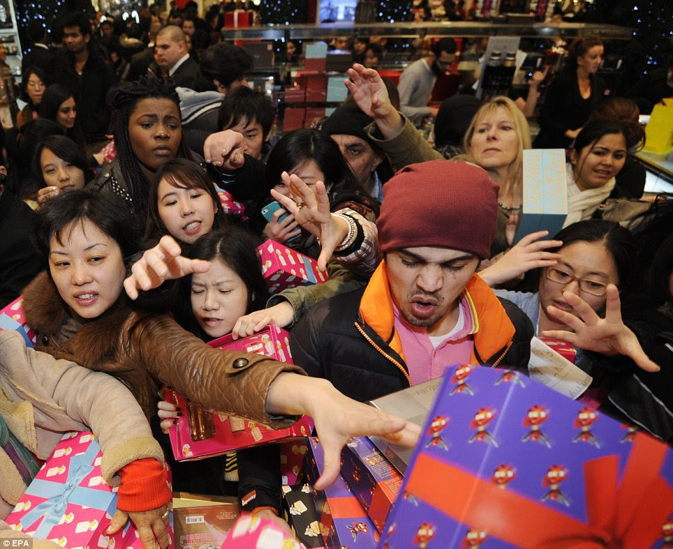 Carnage: Many foreign tourists were among the bargain-hunters who squeezed into Selfridges on Oxford Street today