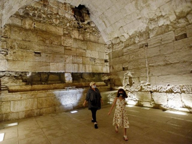 People walk inside a 2,000 year old luxurious banquet hall erected near the Temple Mt. during the Second Temple Period uncovered in the Western Wall tunnels on Thursday. Photo by Debbie Hill/UPI