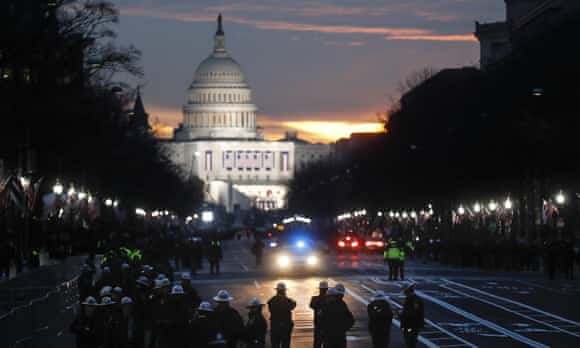 Security personnel gather on Pennsylvania Avenue before the presidential inauguration.