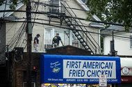 Federal agents investigated the building housing the Rahami family's restaurant in Elizabeth, N.J., Monday, seeking clues in the Manhattan and New Jersey explosions.