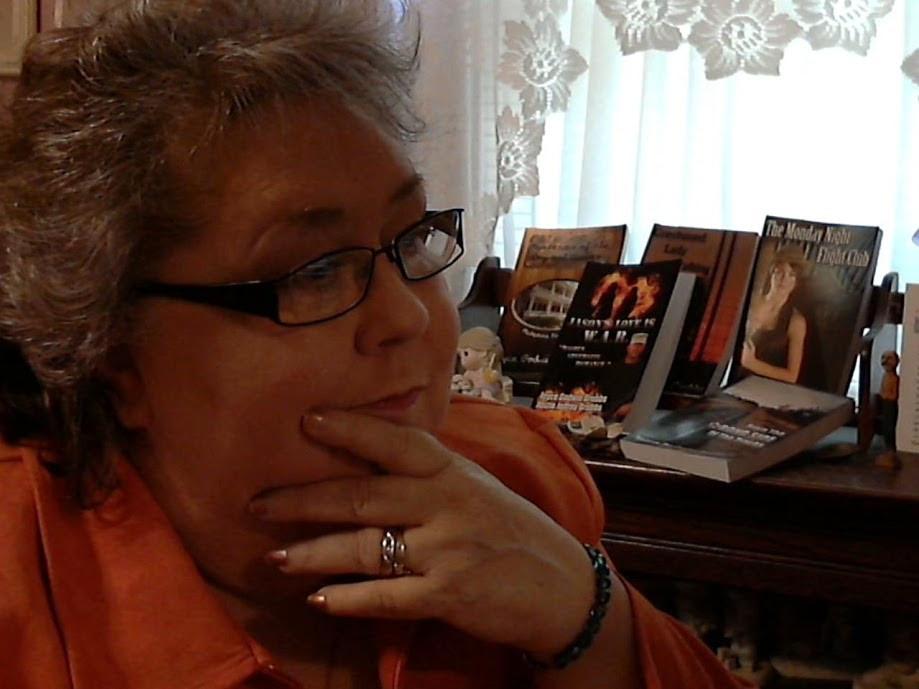 Author pic with books orange