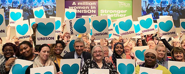 Delegates at UNISON women's conference, and general secretary Dave Prentis, hold up
