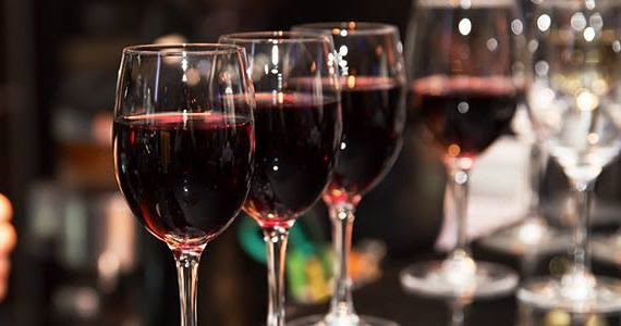 Red wine filled glasses