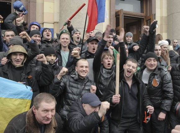 Pro-Russian protesters celebrate after clashes with supporters of Ukraine's new government in central Kharkiv