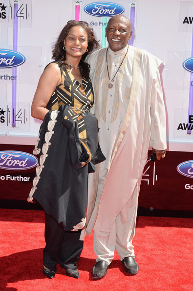 Actor Louis Gossett Jr. (R) and guest attend the BET AWARDS '14 at Nokia Theatre L.A. LIVE on June 29, 2014 in Los Angeles, California.