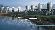 A state of the art lagoon waste management system for a 900-head hog farm, completely automated and temperature-controlled. United States, 2002.