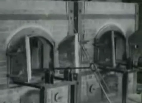 This                 crematory is shown in the film to be in Dachau, with                 single muffle furnaces (35min. 20sec.)