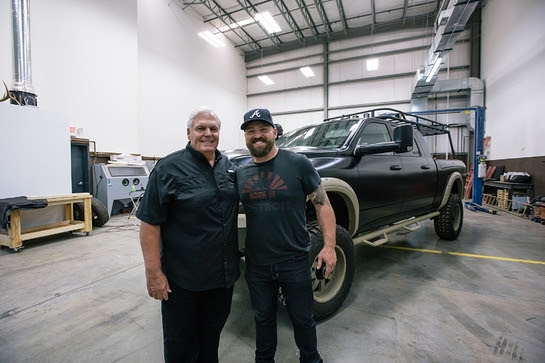 Rick Hendrick and Zac Brown in front of the Ram 2500 Commando being auctioned off for Camp Southern Ground