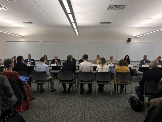 Five students and a teacher sit at a table facing members of the Joint Education Interim Committee to testify about computer science.