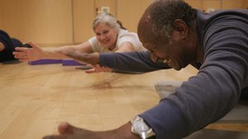 A man on the floor taking part in a yoga session