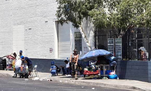 Homeless people take shelter from the sun in Phoenix.