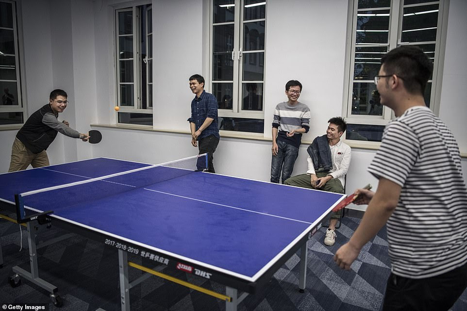 Huawei workers play ping pong in an employee leisure area at the sprawling 'Ox Horn' Research and Development campus