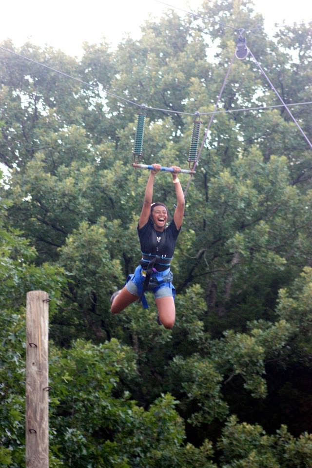 Lady successfully completes The Leap of Faith on The Edge challenge course