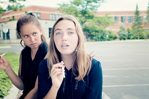 teen girls smoking e-cigarettes