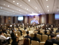 Blurry image of people at a meeting