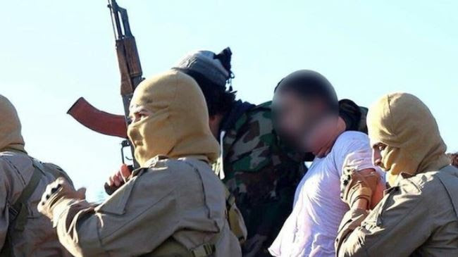 The pro-ISIL Raqqa Media Center posted photos purportedly showing a captured Jordanian pilot.