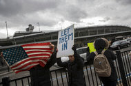 Protesters on Saturday at Kennedy International Airport in New York opposing President Trump's immigration order.