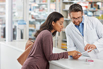 Woman looking at prescription at pharmacy