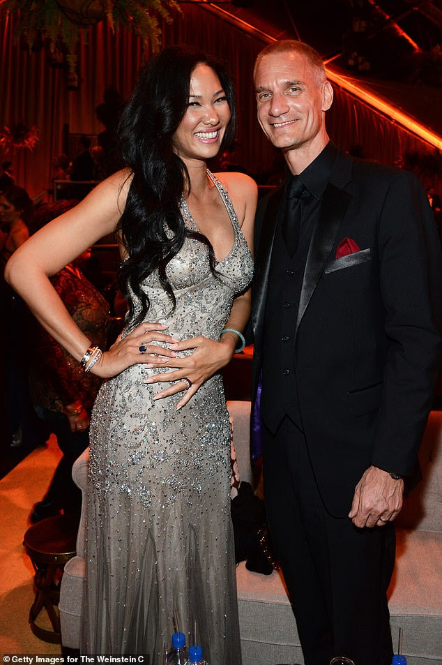 Tim Leissner, pictured with hi wife Kimora Lee Simmons, is facing up to 10 years in prison in the US and in Malaysia and has agreed to pay $43million in fines already for his role in the theft