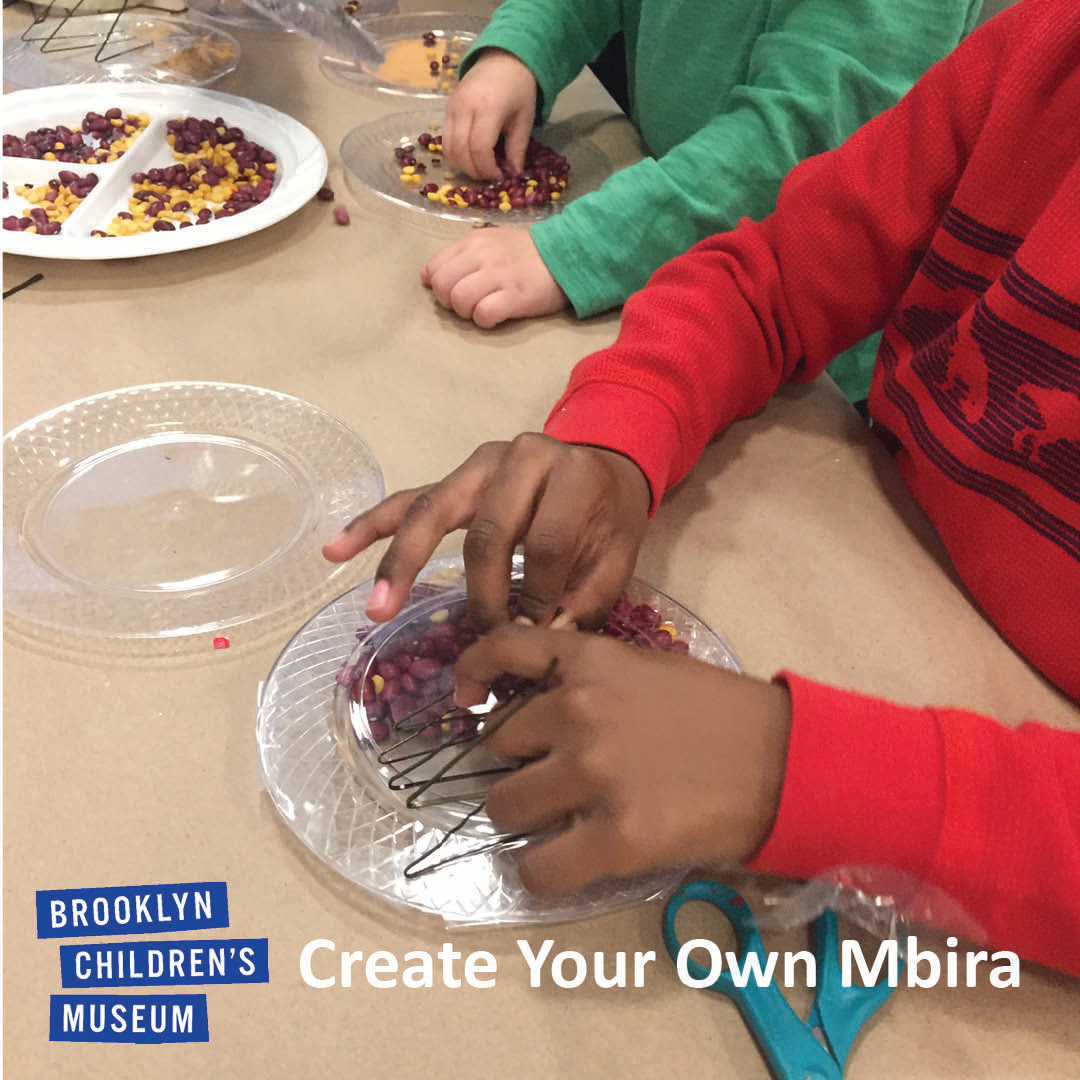 Children's hands making mbiras out of plastic plates and beans