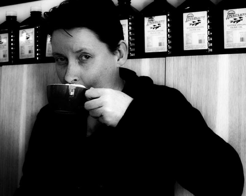 Photo of Tanya Olson sipping coffee