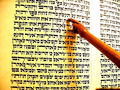 A Torah pointer keeps place in the Hebrew writing                   on the Torah scroll.