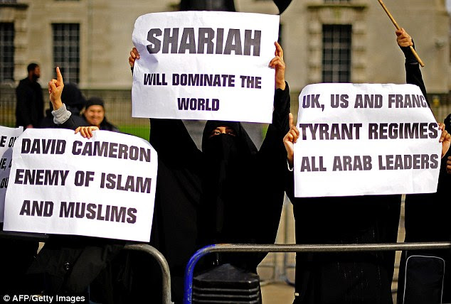 Hardline: Muslim women campaigning for Sharia law during a protest outside Downing Street