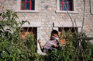 A volunteer tending to the vegetable garden at the Longquan Monastery in northwest Beijing. The temple reopened in 2005 and is now equipped with fingerprint scanners, webcams and iPads for studying sutras, or Buddhist texts.