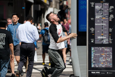 A man sang and danced to a song by the heavy metal band Slipknot playing on a LinkNYC Wi-Fi kiosk in Manhattan on Wednesday.